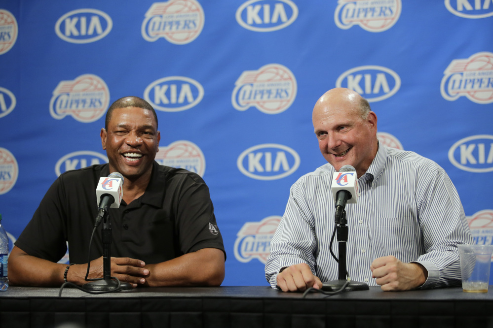 The Associated Press New Los Angeles Clippers owner Steve Ballmer, right, and head coach Doc Rivers, seen at a press conference on Aug. 18, are set to work together through the 2019 season.