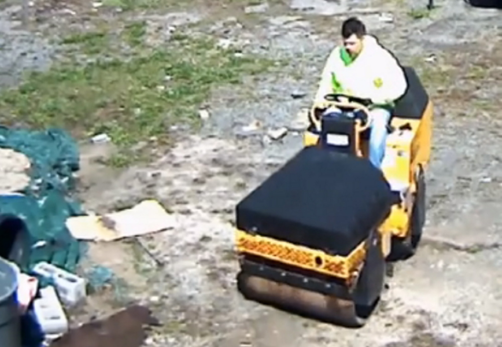 This screen image from video shows a suspect driving a paving roller away from a business in the Bronx