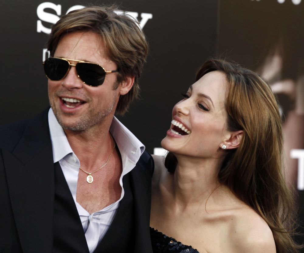 "Cast member Angelina Jolie and Brad Pitt arrive at the premiere of ""Salt"" in Los Angeles in 2010. Jolie and Pitt were married Saturday in Southern France."