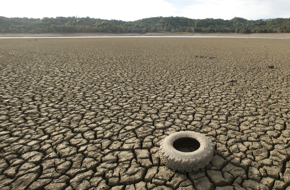 A tire rests on the dry bed of Lake Mendocino in California in February 2014. Some experts considered the drought a preview of the future of climate change.