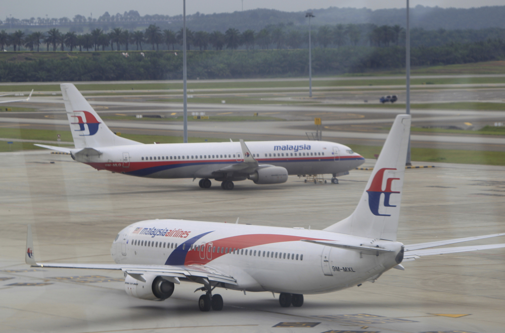 A Malaysia Airlines plane taxies out on the tarmac for departure at Kuala Lumpur International Airport in Sepang, Malaysia, on Friday.