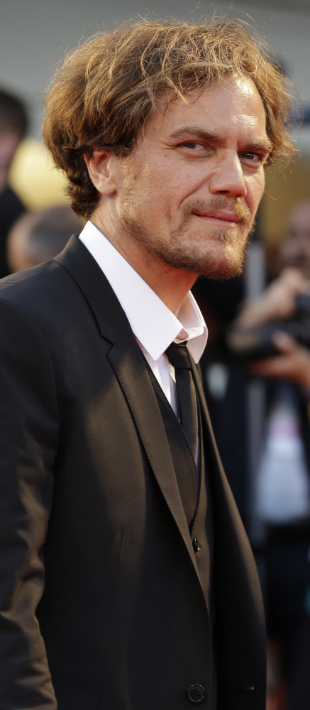 """Actors Michael Shannon, above, and Andrew Garfield, below, arrive for the premier of """"99 Homes"""" at the 71st Venice Film Festival in Italy on Friday. The film's director, Ramin Bahrani, said he was """"dizzied by the corruption"""" in Florida when he was researching his Orlando-set drama on the subprime crisis."""