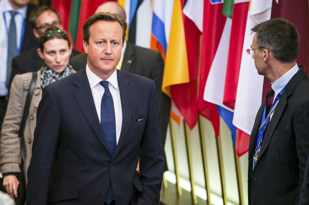 British Prime Minister David Cameron leaves the EU Council building at the end of an EU summit in Brussels early Sunday.