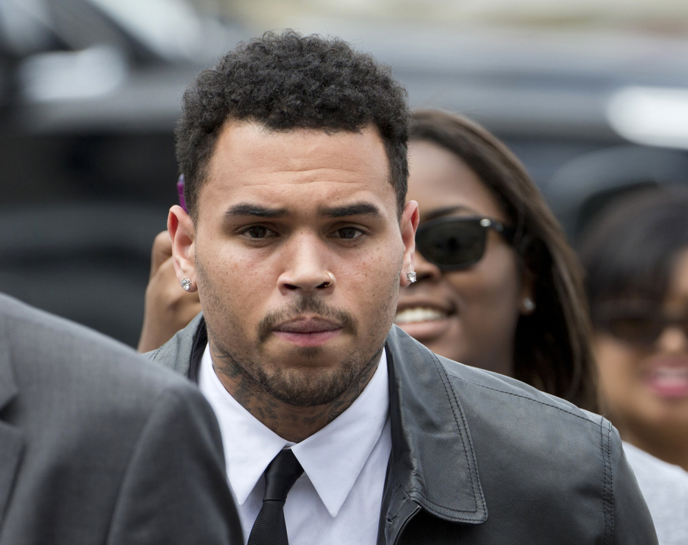 Chris Brown, seen arriving at the D.C. Superior Court in Washington on June 25, is linked to an assault case involving a fan that dates to October 2013.
