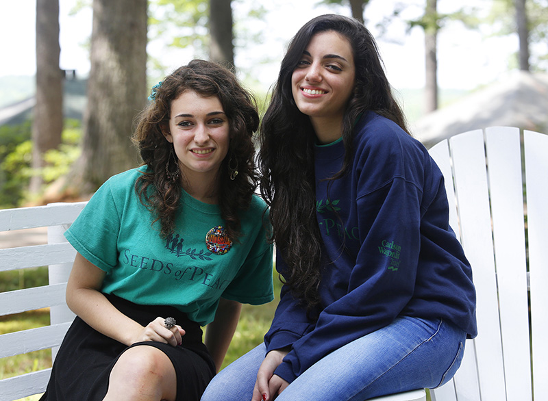 Nitsan, 16, of Modi'in, Israel, left, and Rema, 17, a Palestinian from Israel, are second-year campers at Seeds of Peace. Derek Davis/Staff Photographer