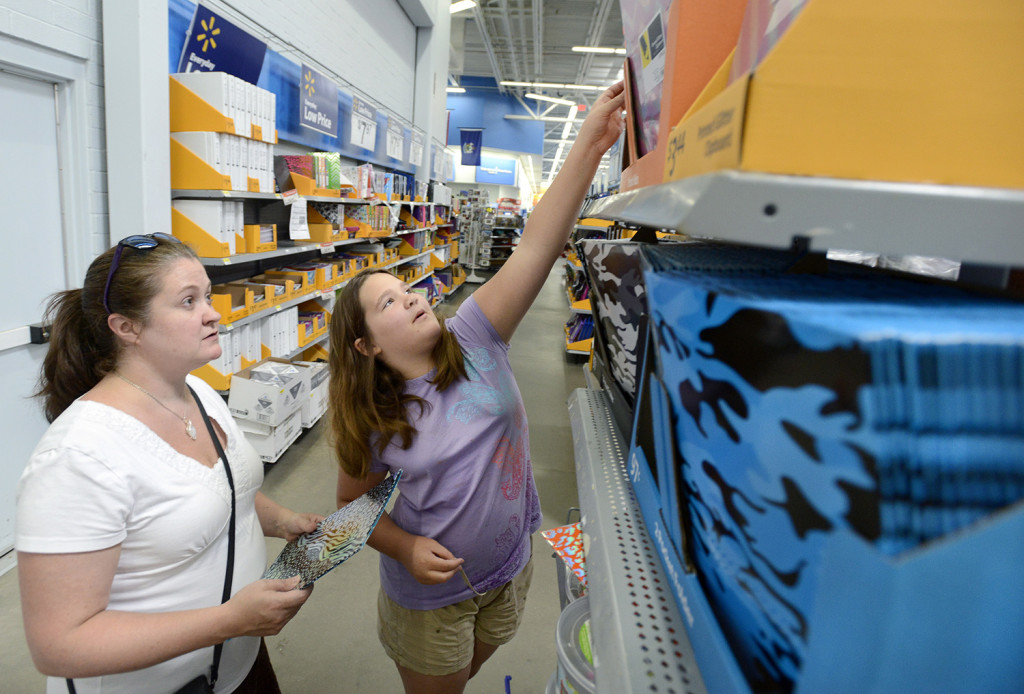 Rigina Lemire from Westbrook and her 10-year old-daughter Saige were among parents and their children shopping for school supplies recently at Walmart in Scarborough.