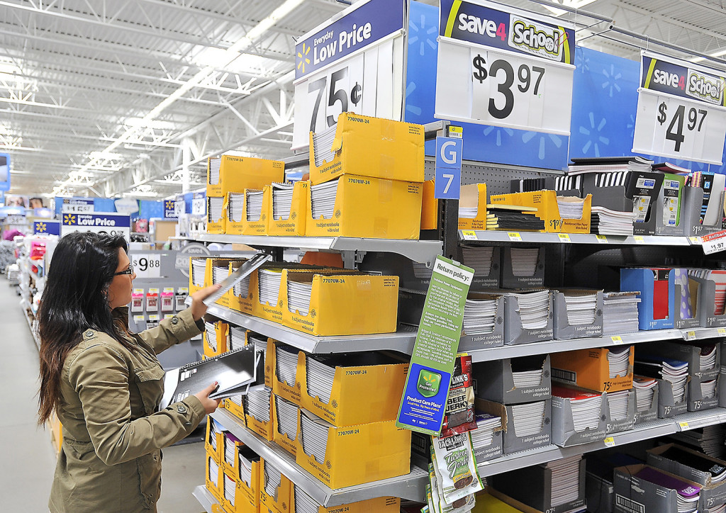 Sarah Patten of Portland, a student at USM and a nanny, selects notebooks at Walmart in Scarborough.