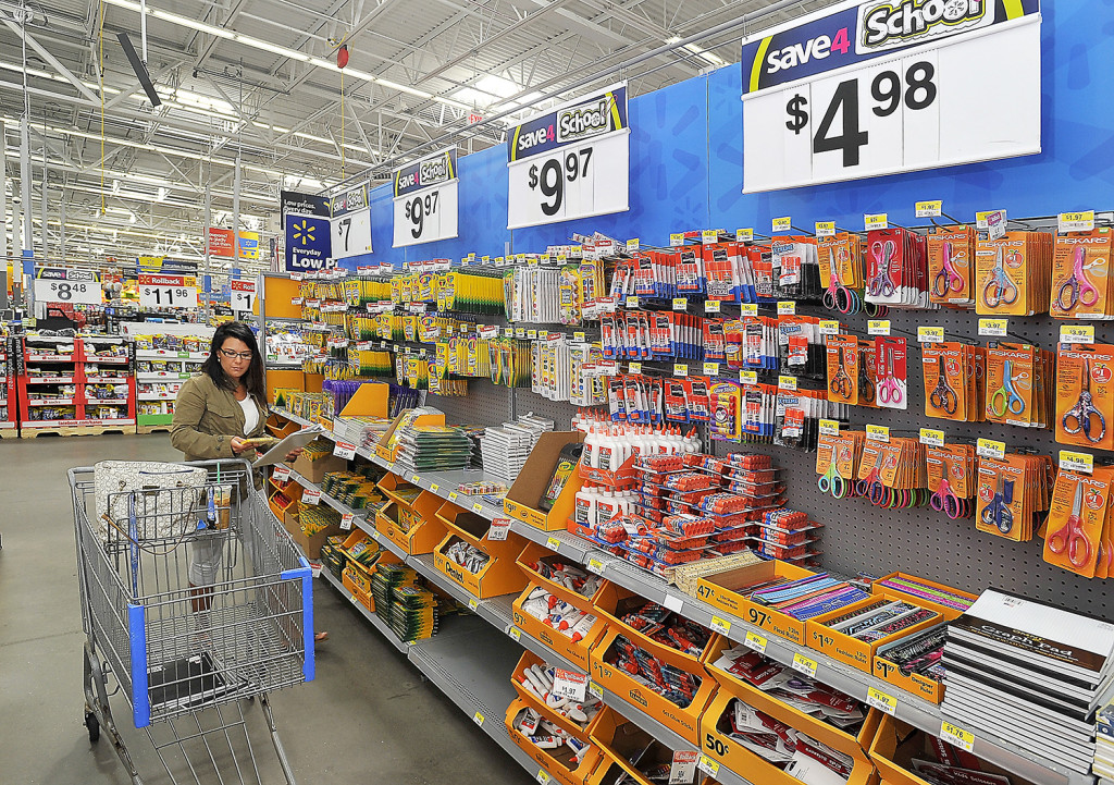 Sarah Patten of Portland, a student at USM, shops for back to school items for herself and a 7-year-old she nannies for at Walmart in Scarborough.