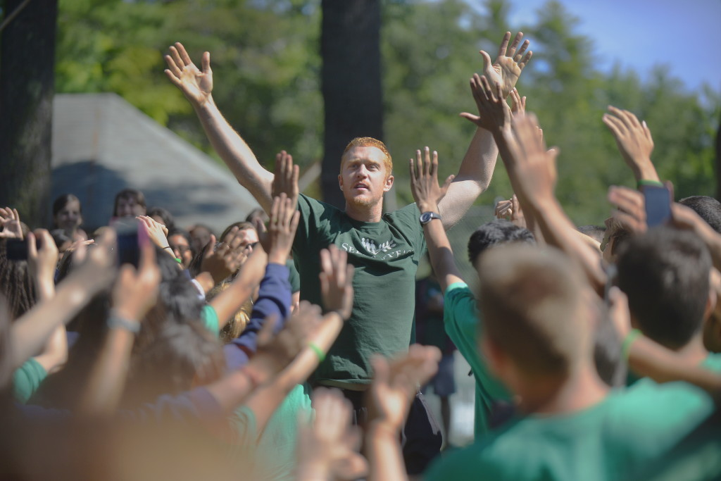 Former Boston Celtic Brian Scalabrine, who has has been coming to the Seeds of Peace camp for the past 11 years, gets a huge reception from the campers on Friday in Otisfield.