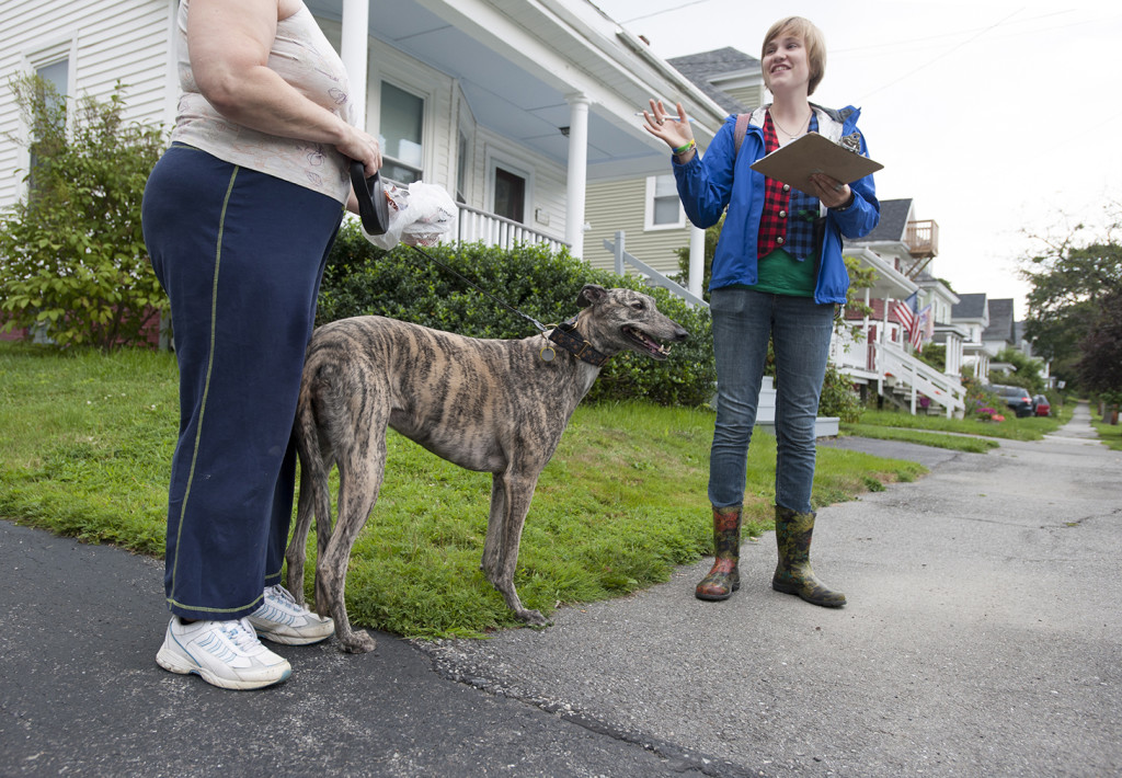 Howard is engaged by a dog walker who declined to be identified as she canvased along Maple Street in Bangor. While not on the list of people who were scheduled to be called on, Howard listened to the woman's concerns and took note of her pledge to vote democrat.