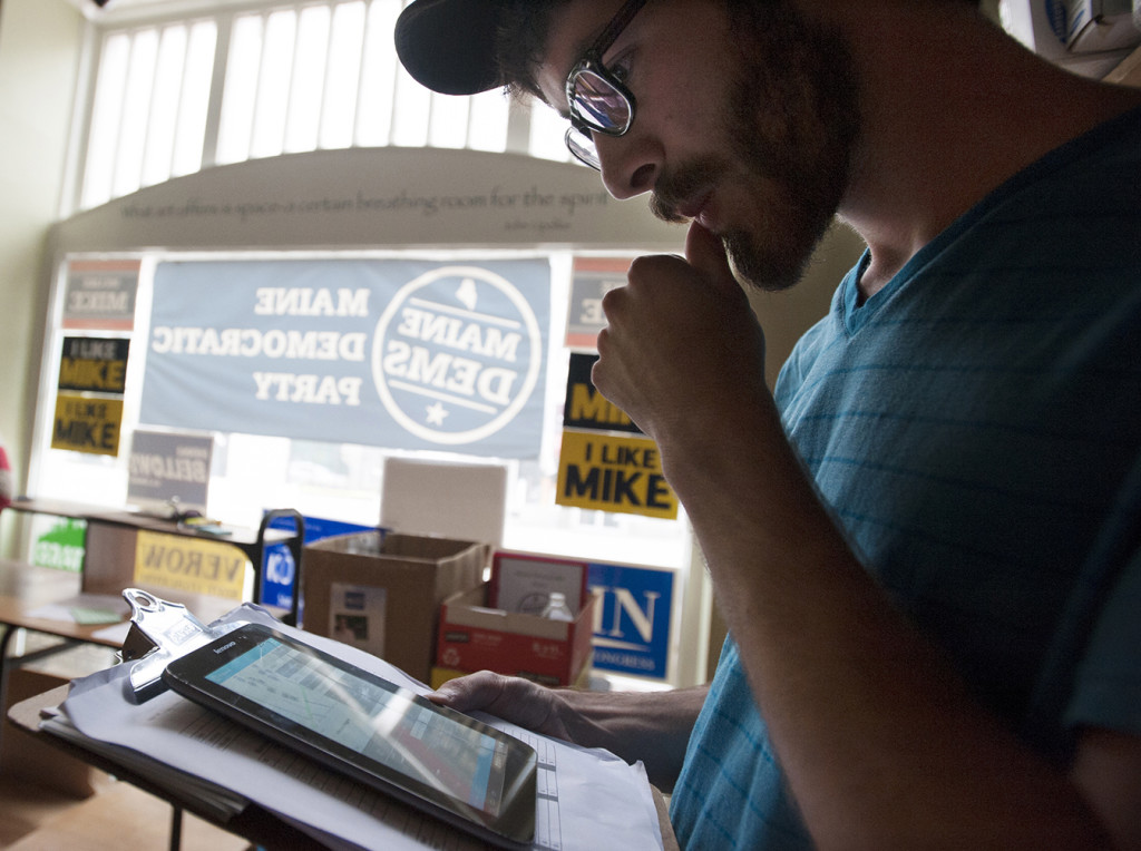 Democratic canvasser Elias Pasquerillo reviews his assignment. He and five others will call on Bangor residents who organizers identified as voters on the fence.