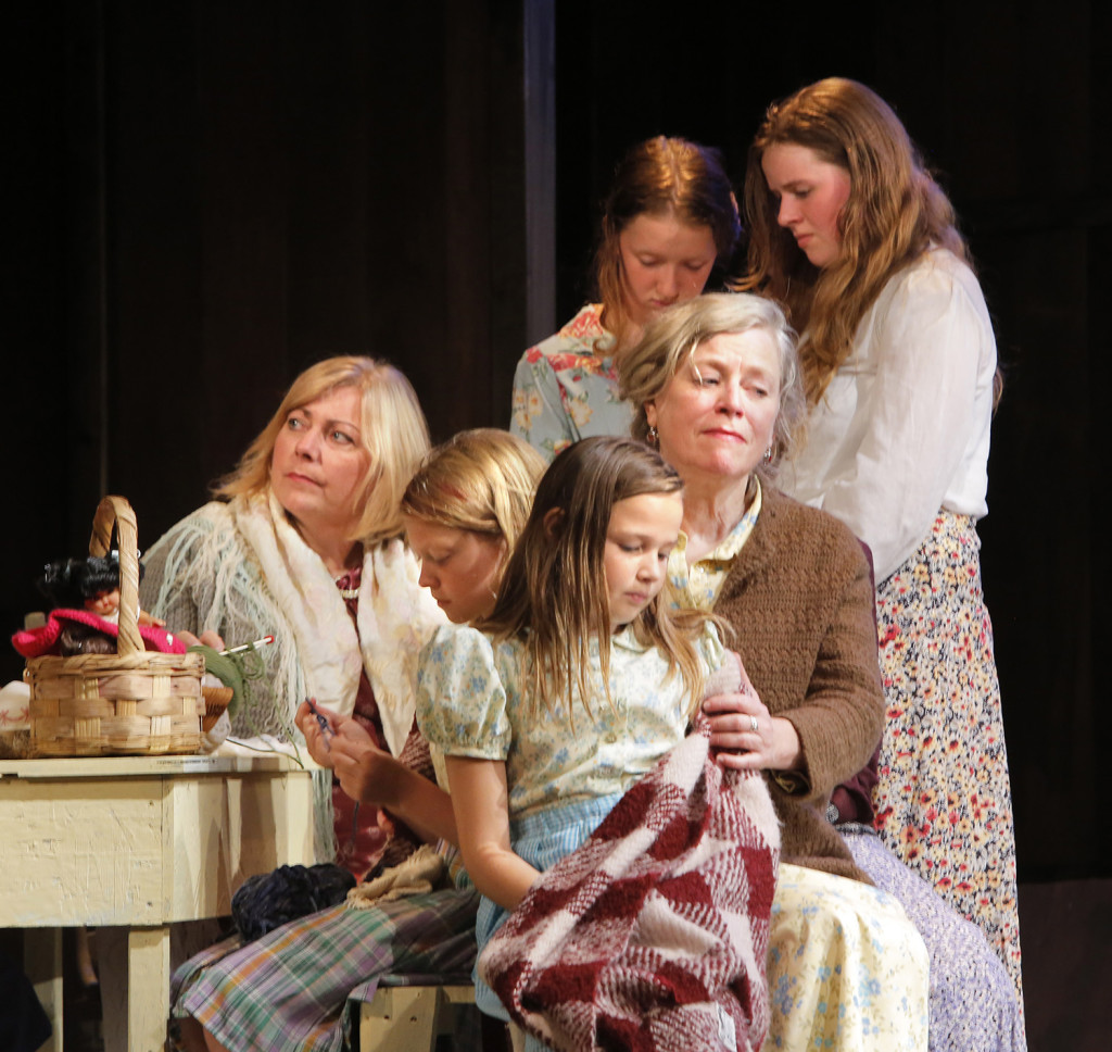 """Women and their daughters look forlorn in this scene set in a kitchen in a Deer Isle house in the play """"The Last Ferryman"""" which depicts the winter of 1934 when Eggemoggin Reach froze solid and ferry service to the island was halted. This caused some islanders to go without heat because fuel oil trucks could no longer get to the island. The harsh winter and halt in ferry service helped the effort to build a bridge to Deer Isle gain momentum."""