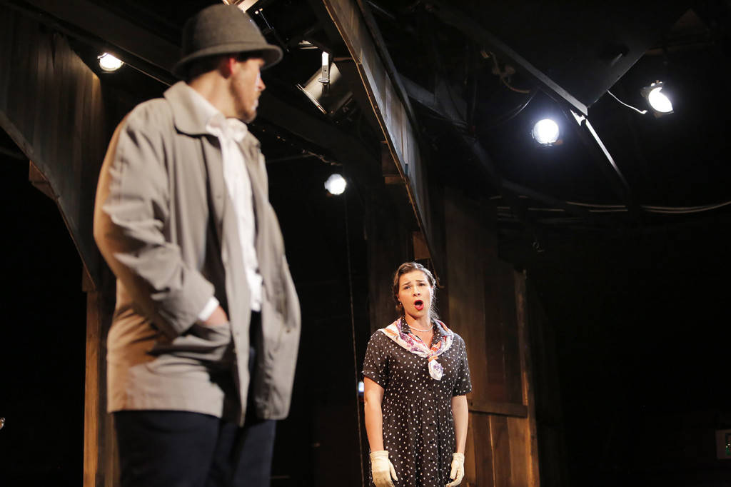 """Donata Cucinotta, playing the role of Annie McGuire, tells ferryman Charlie Scott, played by Jason Martin, that he should stop fighting the effort to build a bridge to Deer Isle in this scene from a dress rehearsal of """"The Last Ferryman"""" at the Stonington Opera House."""