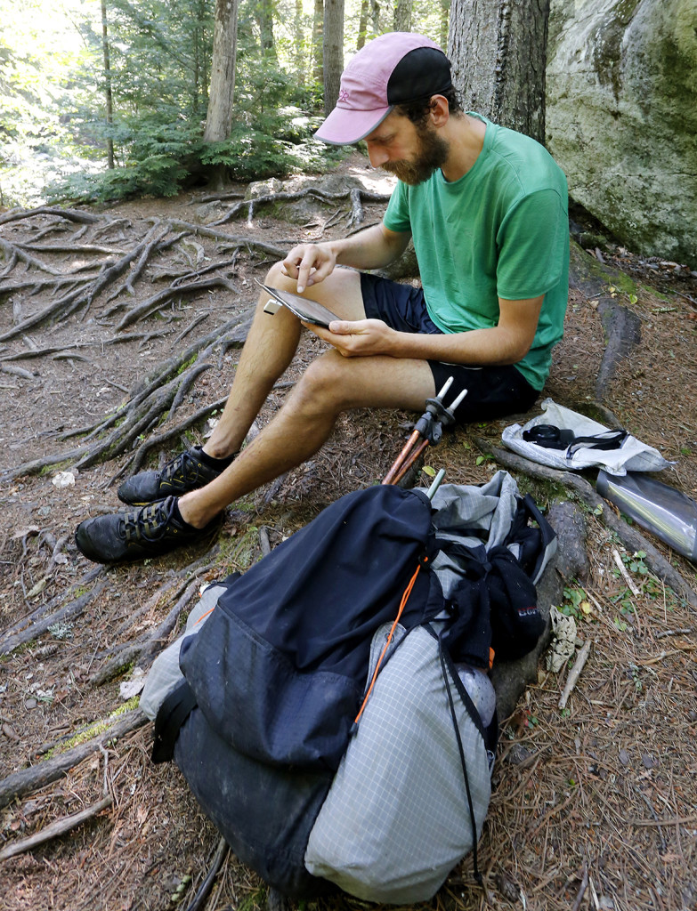 Dave Kallin stops to edit through photos and update his blog, while his family hikes ahead at Gulf Hagas.