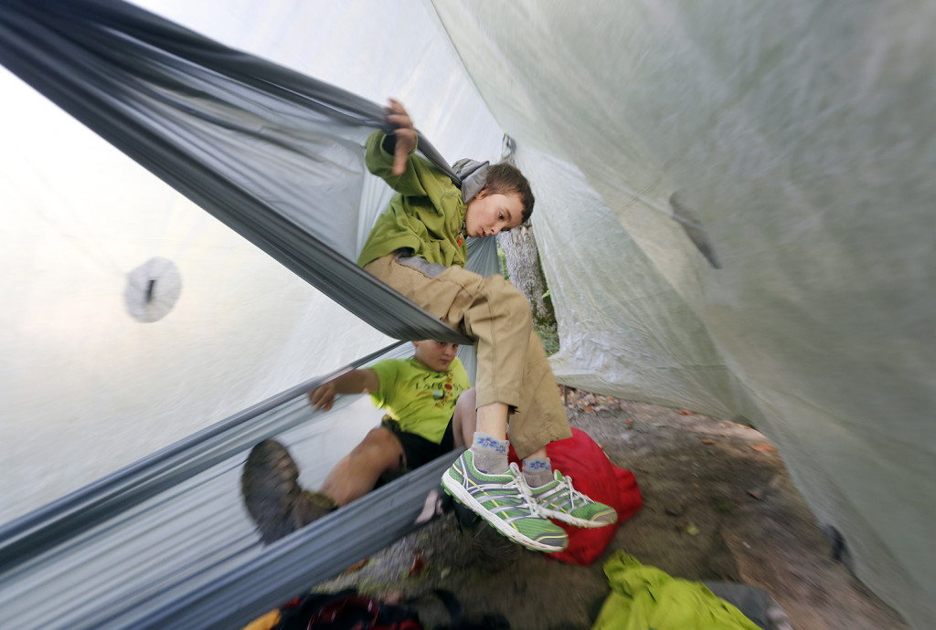 Nathan Kallin, 9, climbs out of the top hammock where he was camping with his family.