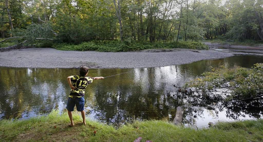 Nathan Kallin casts his telescoping fly rod in a stream where he was camping with his family near the Appalachian Trail.