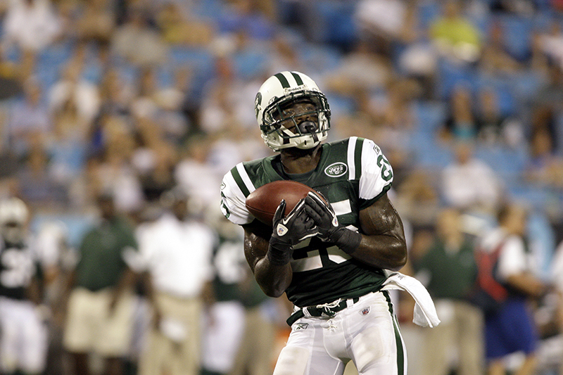 In this 2010 file photo, New York Jets punt returner Joe McKnight catches a punt as the Jets play the Carolina Panthers in an NFL preseason game in Charlotte, N.C. The Associated Press