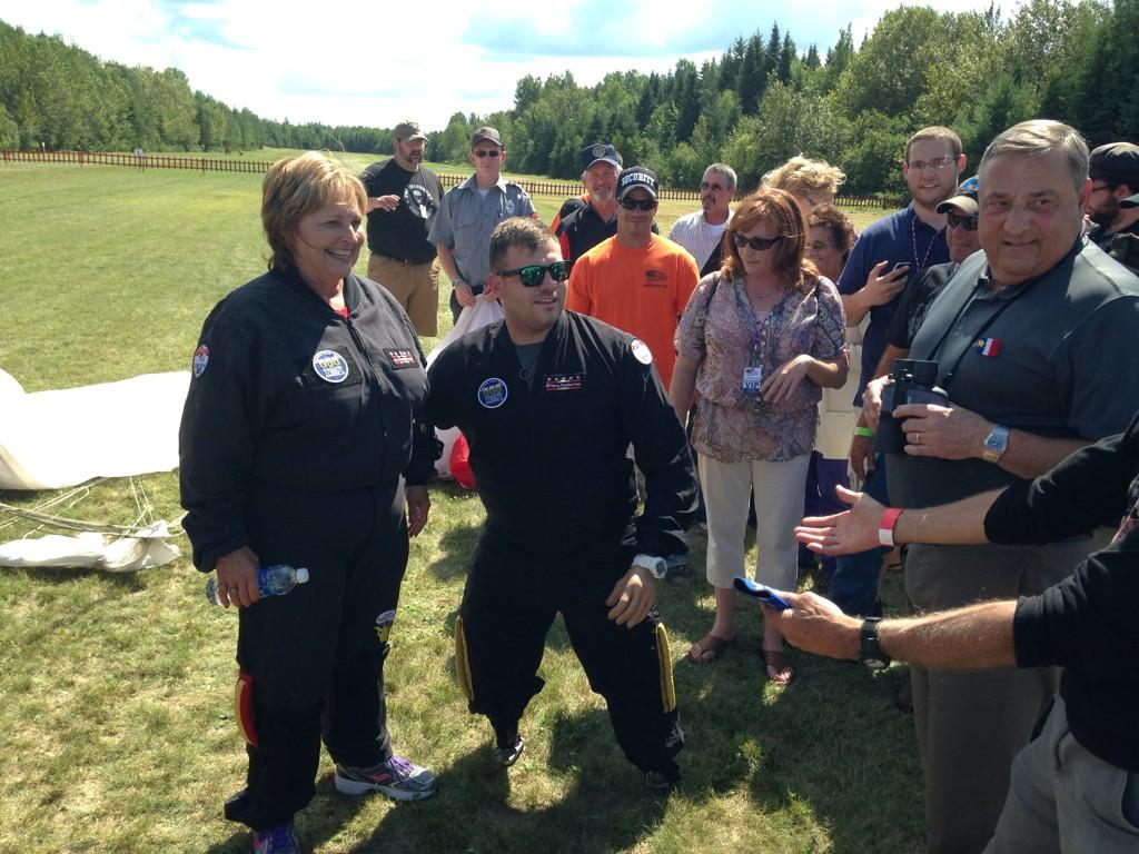 First lady Ann LePage and Staff Sgt. Travis Mills chat with Gov. Paul LePage and others after skydiving Saturday. Photo courtesy WCSH6