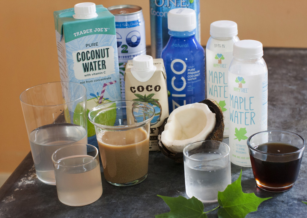 An assortment of trending waters, from left: Trader Joe's pure coconut water, C2O pure coconut water, Coco Cafe vanilla coconut water cafe latte, Zico pure premium coconut water, O.N.E. coconut water, and Happy Tree maple water and maple syrup.