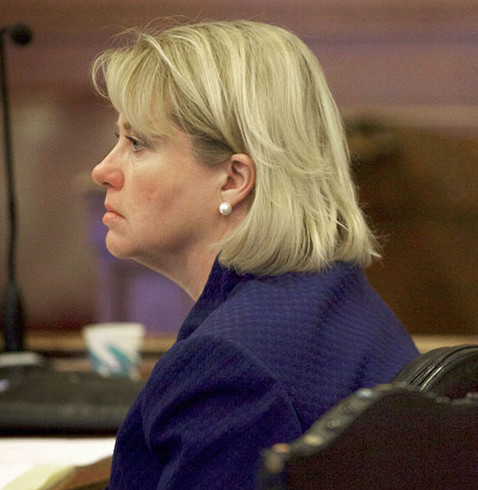 In this file photo, Assistant Attorney General Lisa Marchese (left) and Maine State Police Detective Ethel Ross listen to opening arguments in the Joel Hayden double murder trial pin Portland,  Jan. 7, 2013. Pool photo/Troy R. Bennett.