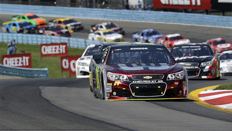Jeff Gordon (24) leads early in a NASCAR Sprint Cup Series auto race at Watkins Glen International, Sunday. The Associated Press