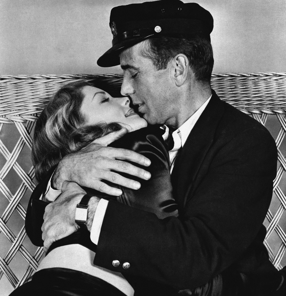 """This 1944 photo, originally released by Warner Bros., shows Humphrey Bogart holding Lauren Bacall in a scene from """"To Have and Have Not."""" Bacall died Tuesday at the age of 89."""