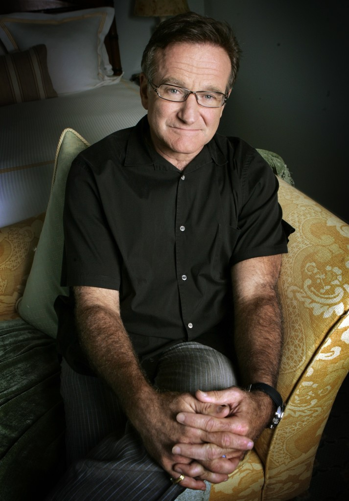"""Robin Williams, posing in 2007 to promote his film """"License To Wed,"""" died in an apparent suicide. He was 63."""