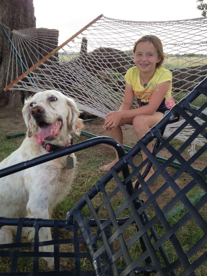 In this photo provided by Danel Grimmett, Willow Grimmett, 10, sits with her agility dog, Emmy, at their home in Edmund, Okla. Willow spent the summer outdoors with the family's English setter, designing and running obstacle courses. The Associated Press
