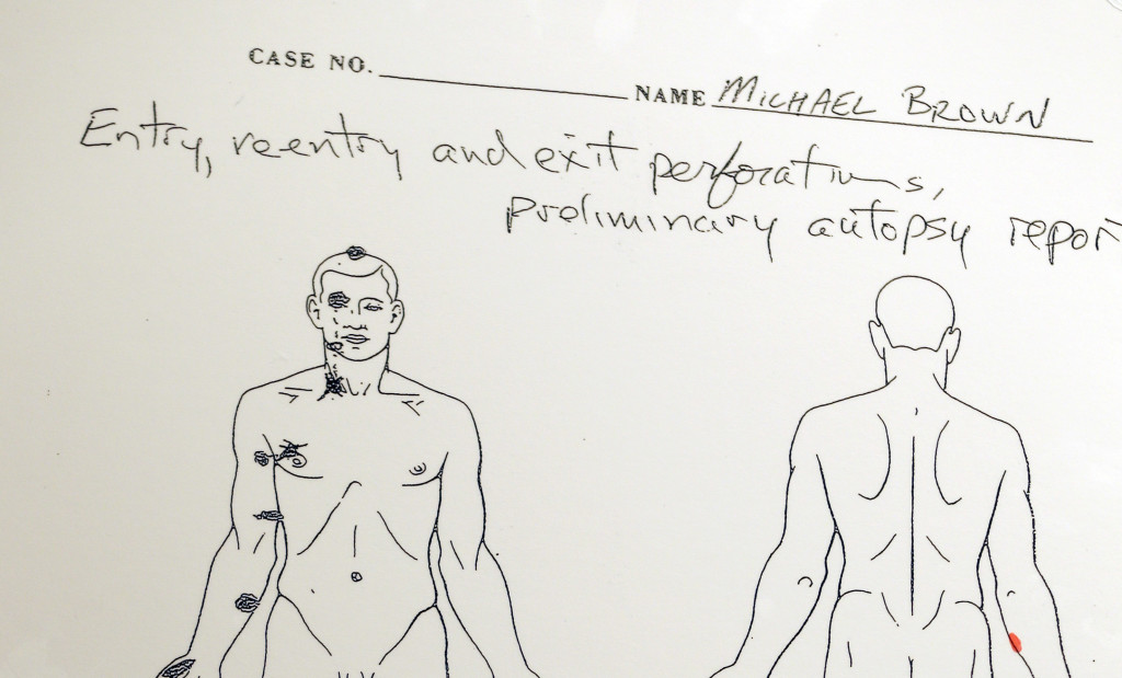 A diagram is shown during a news conference held to share preliminary results of a second autopsy done on Michael Brown on Monday in St. Louis County, Mo. The independent autopsy shows 18-year-old Michael Brown was shot at least six times.
