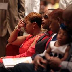 Lesley McSpadden, Michael Brown's mother, closes her eyes during the funeral services for her son Monday at Friendly Temple Missionary Baptist Church in St. Louis. Brown was shot and killed by a Ferguson, Mo., police officer on Aug. 9.