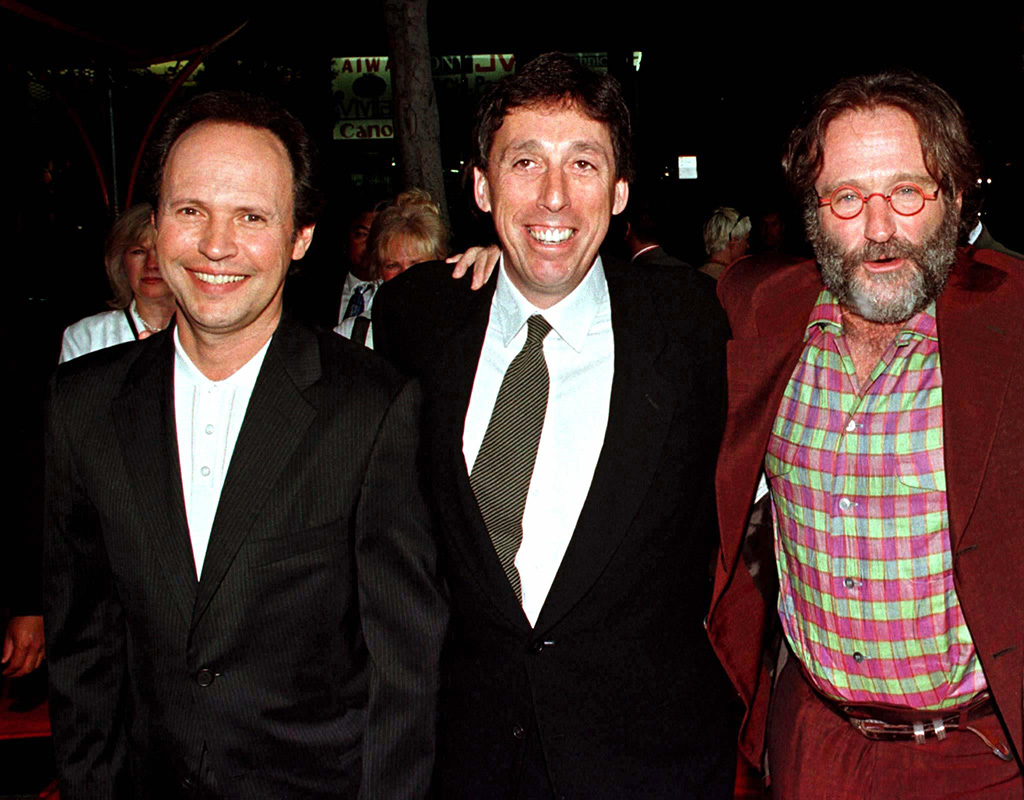 """Hollywood director Ivan Reitman, center, poses with Robin Williams and Billy Crystal as they arrive for the premiere of their new film """"Father's Day"""" in this 1997 file photo."""