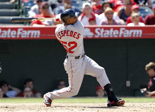 Red Sox' outfielder Yoenis Cespedes hits a three-run home run against the Los Angeles Angels in the seventh inning Sunday in Anaheim, Calif. The Associated Press