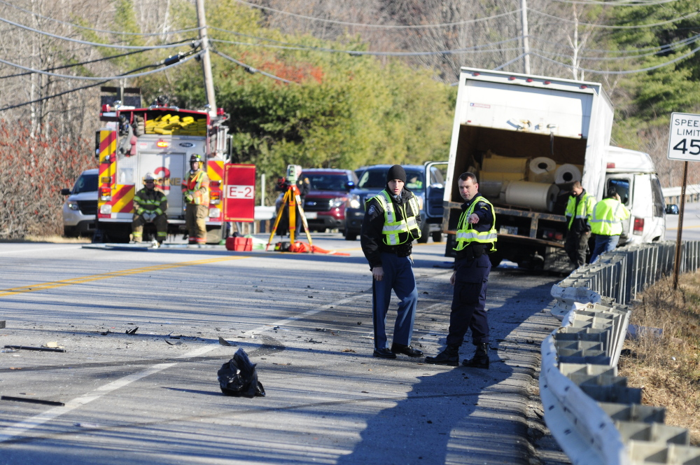 Emergency crews work at the scene of a collision near intersection of U.S. Route 202 and Royal Street on Nov. 21, 2013 in Winthrop.
