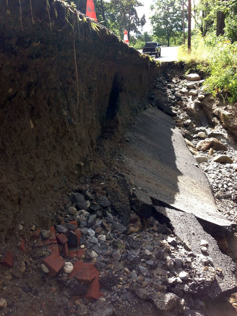 Rain washed out parts of the shoulder of Staples Point Road in Freeport.