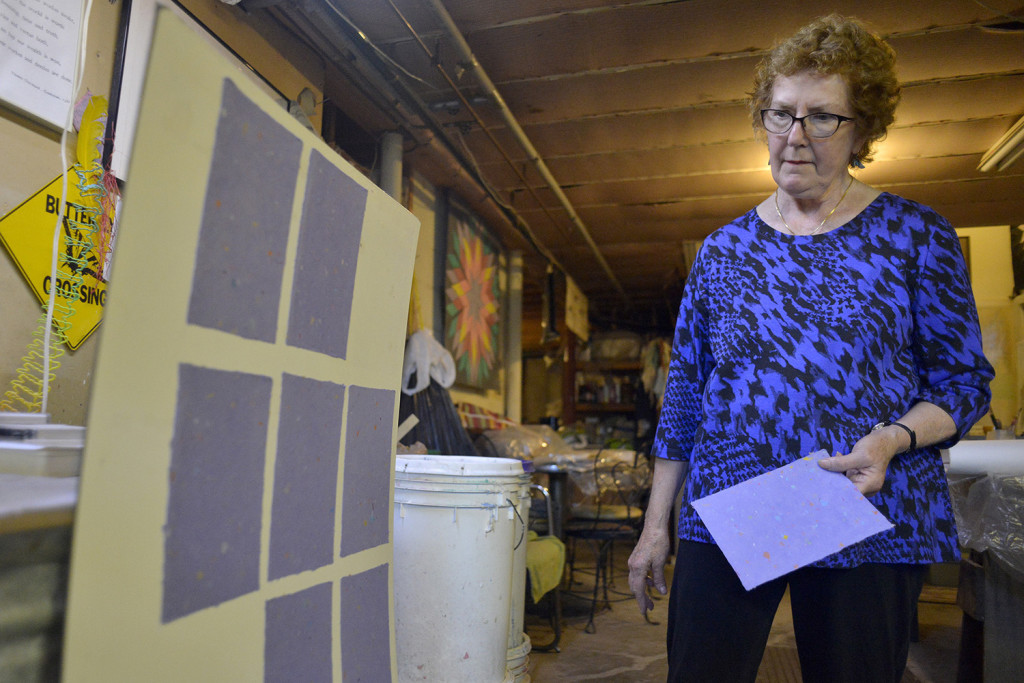 Kuhl shows dried paper sheets at Widgeon Cove Studios. She makes paper and combines different pigments to create landscapes and other artwork.