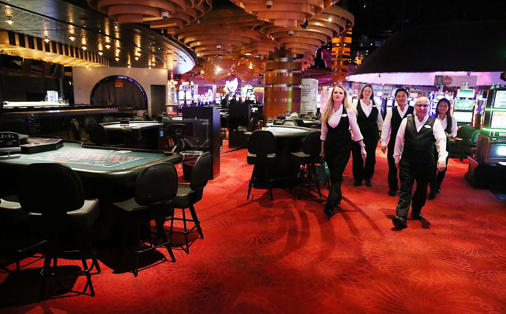 Dealers leave the casino after their last shifts before the casino closes, Tuesday in Atlantic City, N.J.