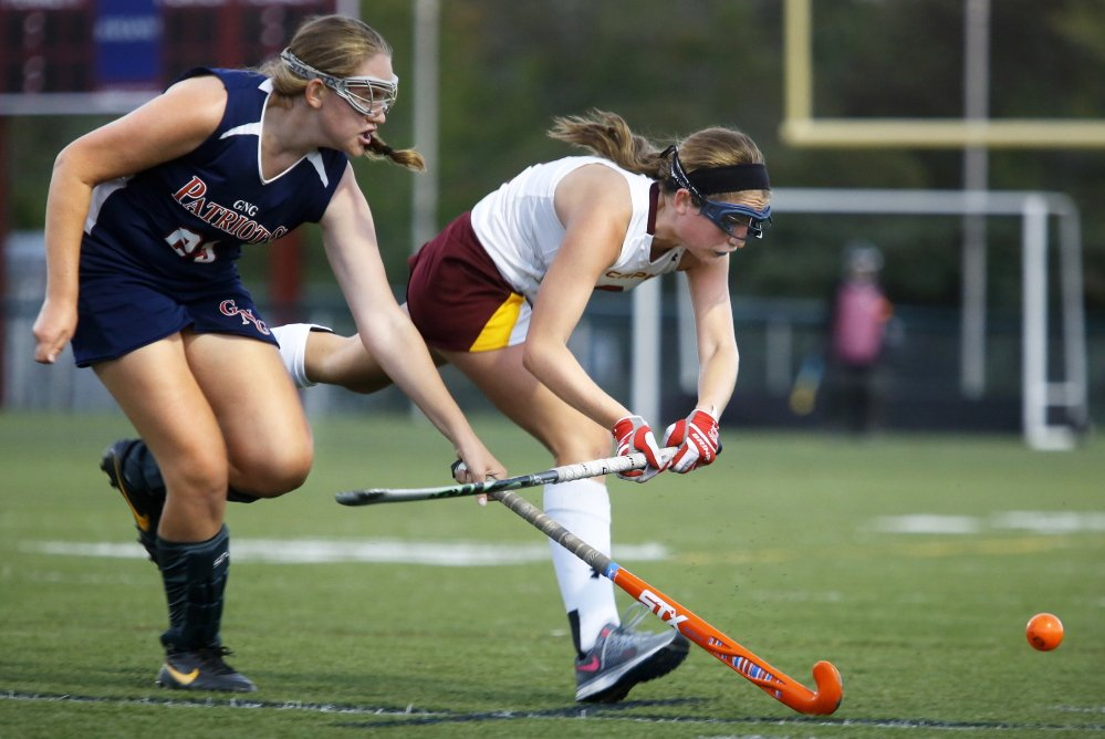 Charlotte Emerson of Cape Elizabeth, right, races to the ball ahead of Melody Larson of Gray-New Gloucester in the second half of Cape Elizabeth's 1-0 win in a Western Maine Conference field hockey opener Wednesday.