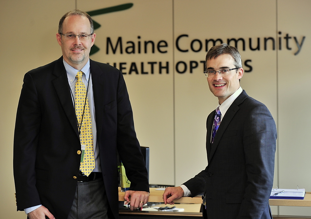 Community Health Options CEO Kevin Lewis, right, with Chief Operating Officer Robert Hillman in 2013.