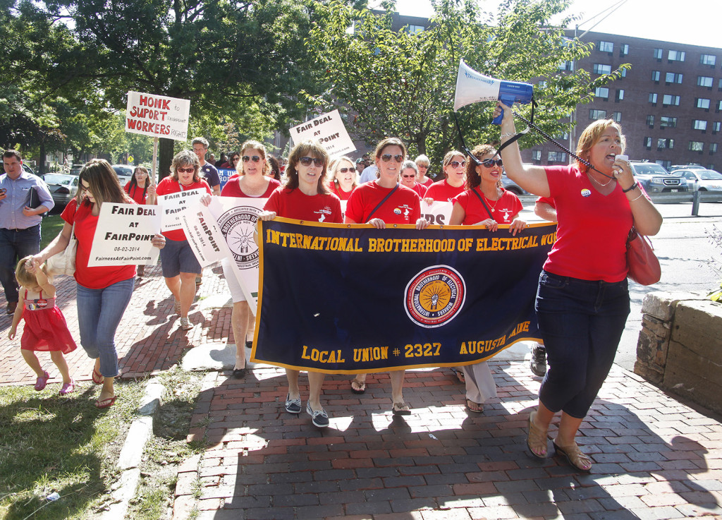 Jen Nappi of Portland, far right, leads fellow Fairpoint employees in a chant as they join the annual Portland Labor Day march from the Irish Heritage Center to Longfellow Square Monday.