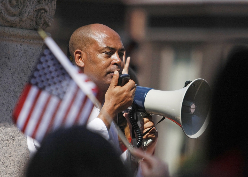Tefere Gebre, executive vice president of the AFL-CIO, leads the crowd in a chant.
