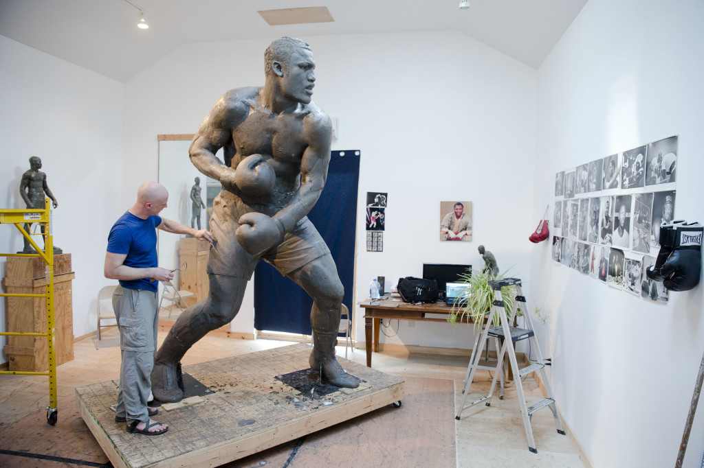 Artist Stephen Layne works on a sculpture of boxing heavyweight champion Joe Frazier in Philadelphia. Next year, the sculpture is expected to be placed near the city's sports stadiums, ending a hurdle-strewn saga that included fundraising problems and the death of the original sculptor. Frazier died in 2011.