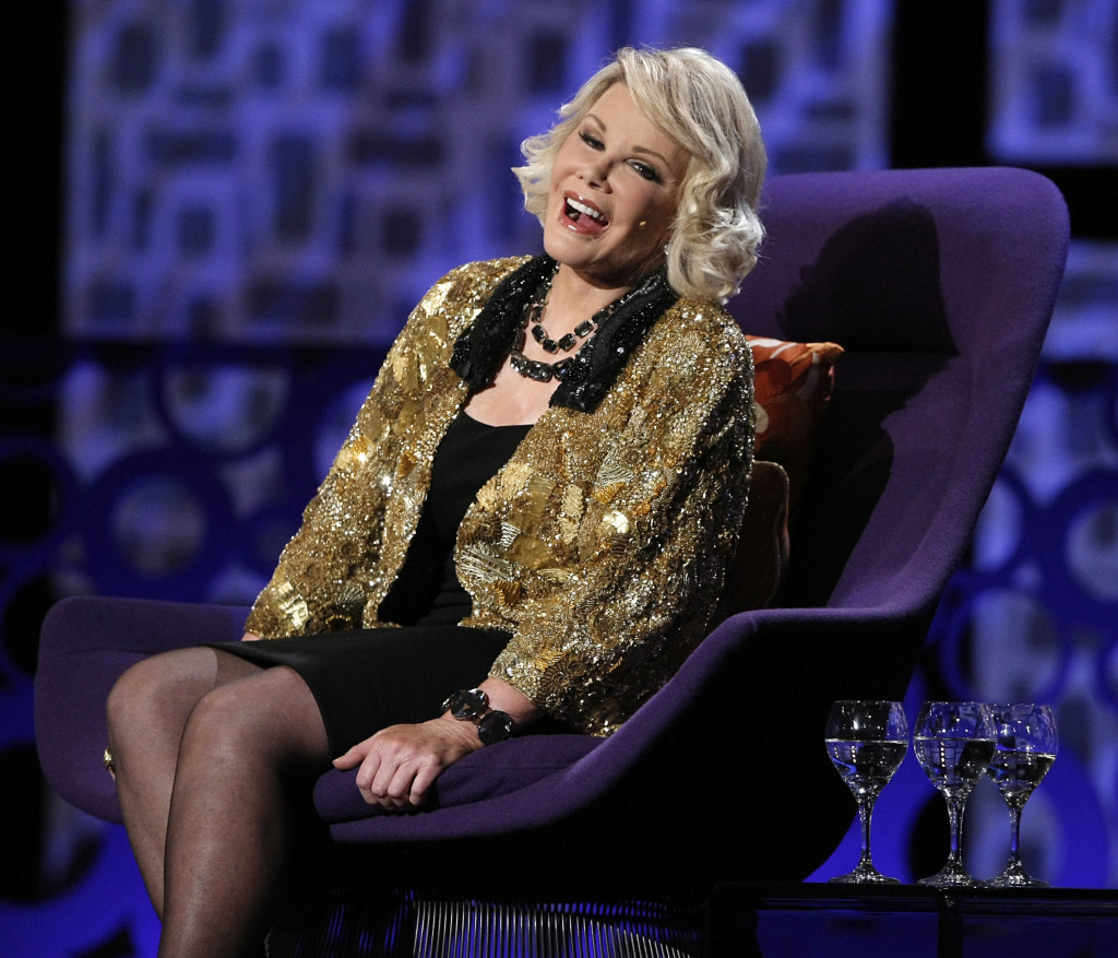 """Joan Rivers greets the audience at the """"Comedy Central Roast of Joan Rivers"""" in Los Angeles in July 2009."""