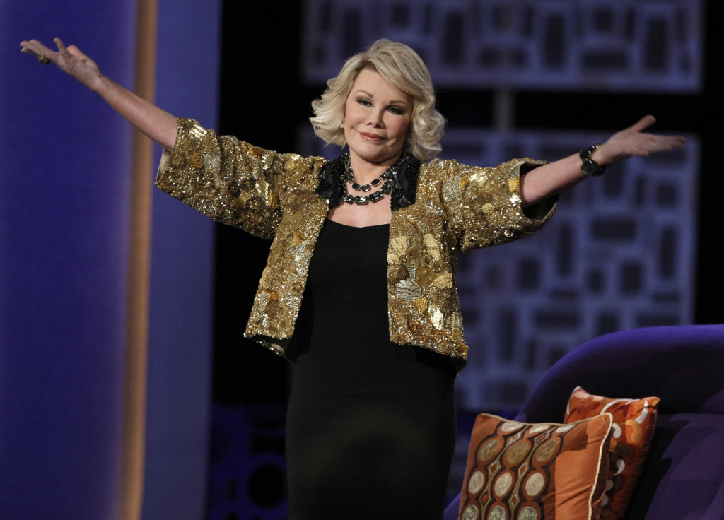 """Joan Rivers greets the audience at the """"Comedy Central Roast of Joan Rivers"""" in 2009."""