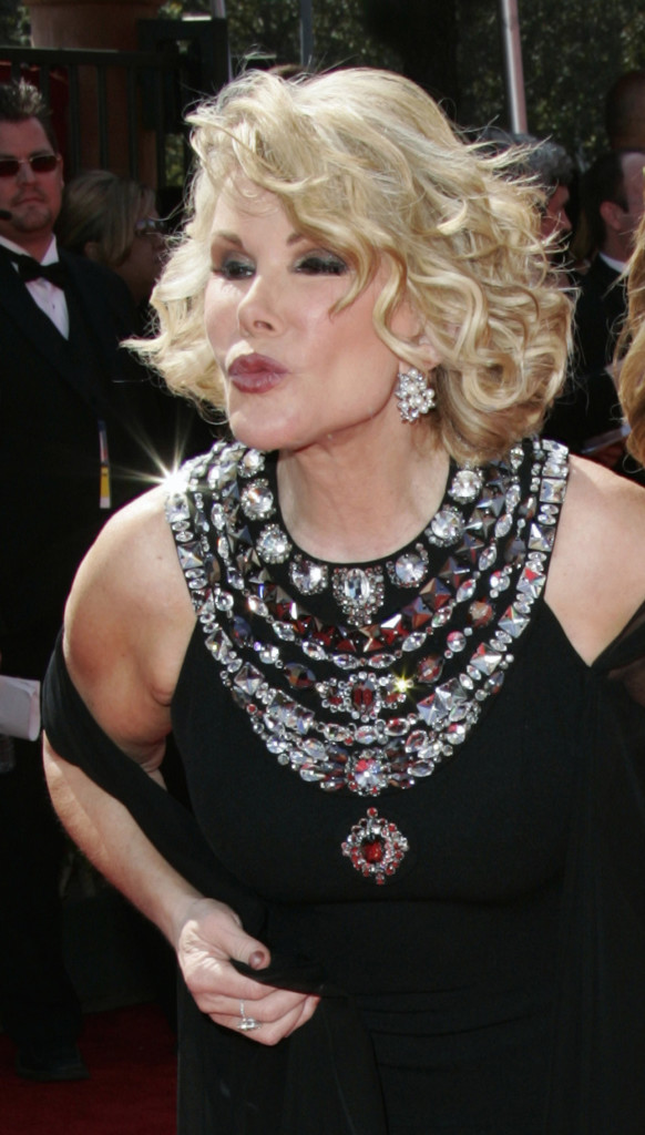 Joan Rivers blows kisses on arrival at the 2005 Primetime Emmy Awards in Los Angeles.