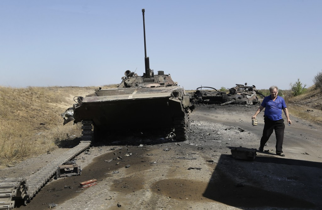 A column of destroyed Ukrainian military vehicles is seen near the village of Novokaterynivka, eastern Ukraine, Tuesday. Ukrainian troops have suffered a string of major military losses over the past week in their offensive against Russian-backed separatist rebels, losing large swathes of territory and having hundreds of soldiers captured. The associated Press