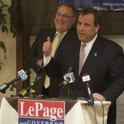asd;flkj;lkj .... Bangor, Maine-- 10-28-2014-- Governor Paul LePage, left, listens as N.J. Governor Chris Christie, right, stumps on behalf of LePage during a rally at the Bangor Banquet and Conference Center on Tuesday.