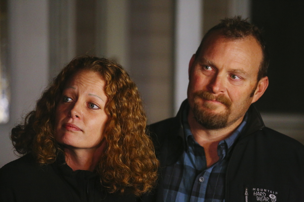 Kaci Hickox and boyfriend, Ted Wilbur, take questions about Maine's quarantine policy outside Wilbur's home in Fort Kent on Wednesday.