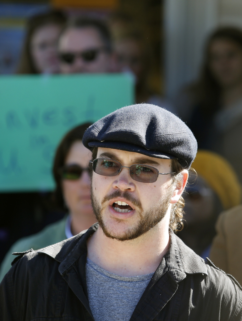 Alexander Knight, a junior with a double major in mathematics and physics at the University of Southern Maine, speaks at a press conference Monday after the announcement of faculty layoffs.