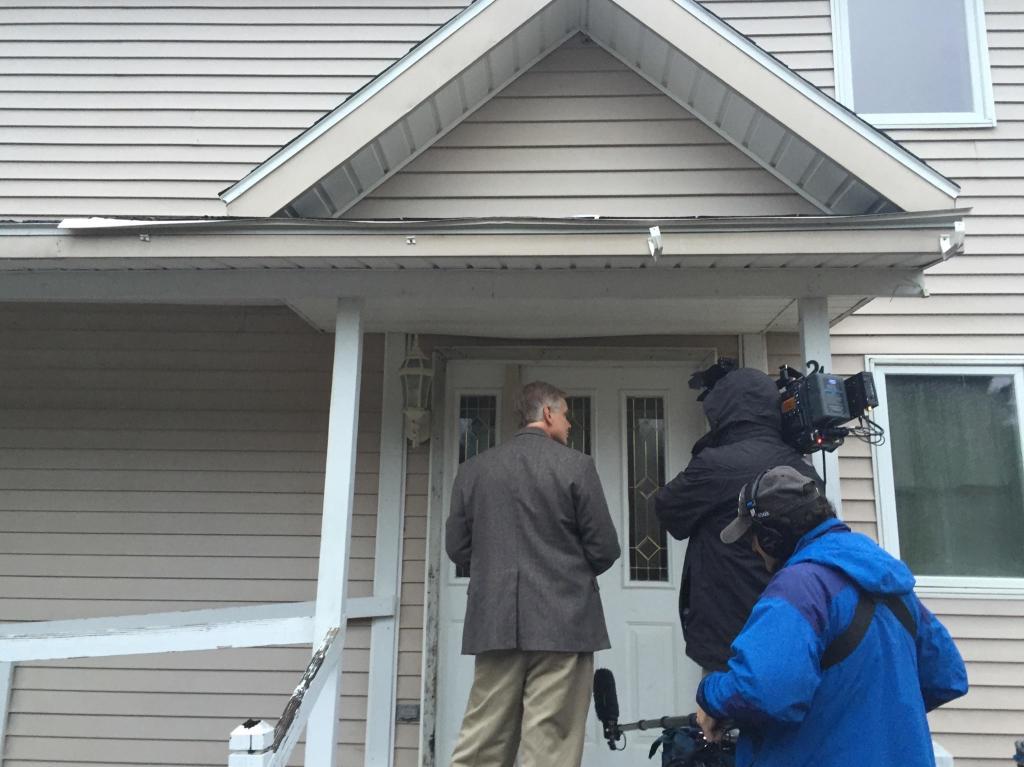 An NBC news team knocks on the door of nurse Kaci Hickox's Fort Kent house Wednesday morning.