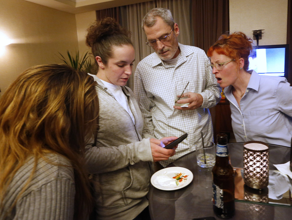 Supporters of Yes on 1 check results from campaign headquarters at the Embassy Suites hotel in Portland. Left to right are Hope Cruser of Edgecomb, Sara Boston of Edgecomb, Bobby Silcott of Naples and Maureen Topa of Westbrook.